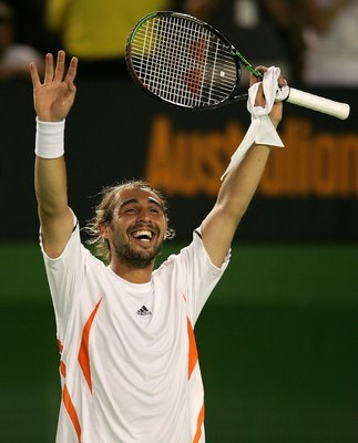 MELBOURNE, AUSTRALIA - JANUARY 22:  Marcos Baghdatis of Cyprus celebrates victory in his fourth round match against Andy Roddick of the USA  during day seven of the Australian Open at Melbourne Park January 22, 2006 in Melbourne, Australia. (Photo by Cliv