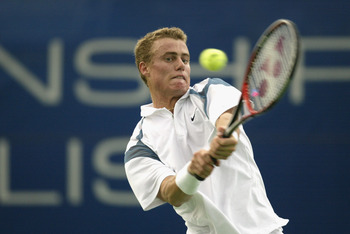 INDIANAPOLIS, IN - AUGUST 14:  Lleyton Hewitt of Australia hits a backhanded return against Alberto Martin of Spain during the second round of the RCA Championships August 14, 2002, at the Indianapolis Tennis Center in Indianapolis, Indiana.    (Photo by