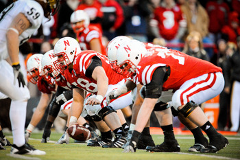 LINCOLN, NE - NOVEMBER 26: Mike Caputo #58 of the Nebraska Cornhuskers and the rest of the Nebraska offensive line powered their way past the Colorado Buffaloes during their game at Memorial Stadium on November 26, 2010 in Lincoln, Nebraska. Nebraska defe