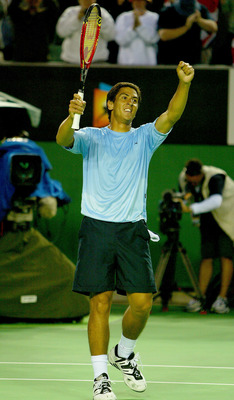 MELBOURNE, AUSTRALIA - JANUARY 24: Guillermo Canas of Argentina celebrates his victory over Tim Henman of Great Britain during day six of the Australian Open Grand Slam at Melbourne Park January 24, 2004 in Melbourne, Australia. (Photo by Clive Brunskill/