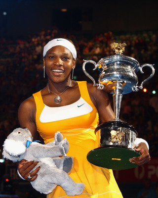 MELBOURNE, AUSTRALIA - JANUARY 30:  Serena Williams of the United States of America poses with the Daphne Akhurst Trophy after winning her women's final match against Justine Henin of Belgium during day thirteen of the 2010 Australian Open at Melbourne Pa