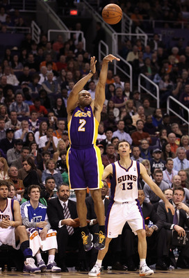 PHOENIX, AZ - JANUARY 05:  Derek Fisher #2 of the Los Angeles Lakers puts up a shot against the Phoenix Suns during the NBA game at US Airways Center on January 5, 2011 in Phoenix, Arizona. The Lakers defeated the Suns 99-95.  NOTE TO USER: User expressly