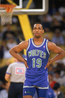 LOS ANGELES - 1990:  Tony Campbell #19 of the Minnesota Timberwolves looks on in a game against the Los Angeles Lakers at the Great Western Forum in Los Angeles, California, during the 1989-1990 NBA season.  (Photo by Ken Levine/Getty Images)