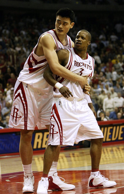 HOUSTON - APRIL 25:   Yao Ming #11 of the Houston Rockets holds Steve Francis #3 out of an altercation with the Los Angeles Lakers during Game four of the Western Conference Quarterfinals during the 2004 NBA Playoffs on April 25, 2004 at the Toypota Cente