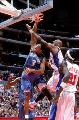 20 Dec 2000:  LaPhonso Ellis #3 of the Minnesota Timberwolves makes a slam dunk as he is blocked by Lamar Odom #7 of the Los Angeles Clippers at the STAPLES Center in Los Angeles, California.  The Clippers defeated the Timberwolves 103-97.    NOTE TO USER