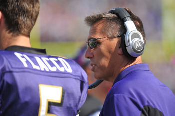 BALTIMORE, MD - OCTOBER 10: Quarterbacks coach Jim Zorn of the Baltimore Ravens coaches against the Denver Broncos at M&T Bank Stadium on October 10, 2010 in Baltimore, Maryland. Players wore pink in recognition of Breast Cancer Awareness Month. The Raven