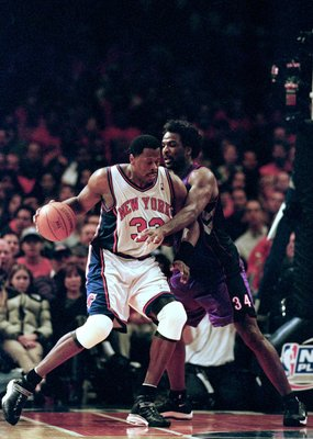 23 Apr 2000: Patrick Ewing #33 of the  New York Knicks dribbles the ball to the basket as he is blocked by Charles Oakley #34 of the Toronto Raptors during round one of the NBA Playoffs at the Madison Square Garden in New York. The Knicks defeated the Rap