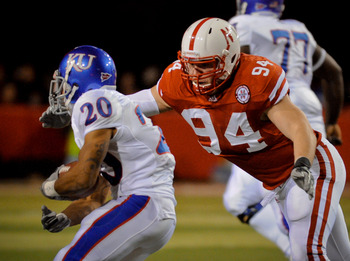 LINCOLN, NE - NOVEMBER 13: Jared Crick #94 of the Nebraska Cornhuskers runs down D.J. Beshears #20 of the Kansas Jayhawks during first half action of their game at Memorial Stadium on November 13, 2010 in Lincoln, Nebraska.  (Photo by Eric Francis/Getty I