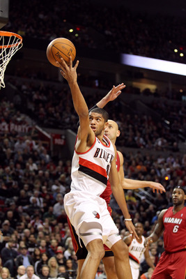PORTLAND, OR - JANUARY 09: Nicolas Batum #88 of the Portland Trail Blazers lays it up over Zydrunas Ilgauskas #11 of the Miami Heat during a game on January 9, 2011 at the Rose Garden Arena in Portland, Oregon. NOTE TO USER: User expressly acknowledges an