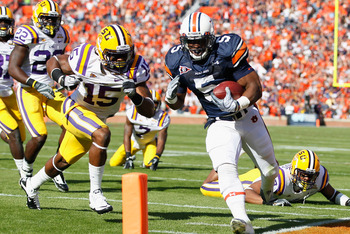 AUBURN, AL - OCTOBER 23:  Michael Dyer #5 of the Auburn Tigers against Brandon Taylor #15 of the LSU Tigers at Jordan-Hare Stadium on October 23, 2010 in Auburn, Alabama.  (Photo by Kevin C. Cox/Getty Images)