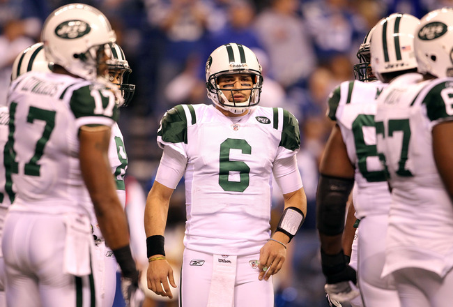 INDIANAPOLIS, IN - JANUARY 08:  Quarterback Mark Sanchez #6 of the New York Jets looks as the Jets get in an offensive huddel against the Indianapolis Colts during their 2011 AFC wild card playoff game at Lucas Oil Stadium on January 8, 2011 in Indianapol