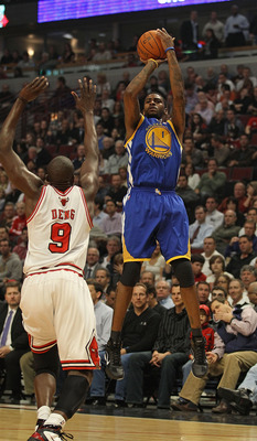 CHICAGO, IL - NOVEMBER 11: Dorell Wright #1 of the Golden State Warriors puts up a shot over Loul Deng #9 of the Chicago Bulls at the United Center on November 11, 2010 in Chicago, Illinois. The Bulls defeated the Warriors 120-90. NOTE TO USER: User expre