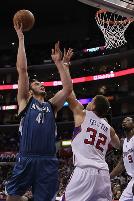 LOS ANGELES, CA - DECEMBER 20:  Kosta Koufos #41 of the Minnesota Timberwolves drives to the basket over Blake Griffin #32 of the Los Angeles Clippers during the first half at Staples Center on December 20, 2010 in Los Angeles, California. NOTE TO USER: U