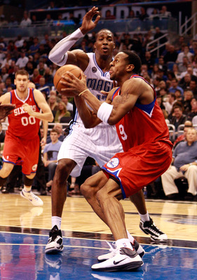 ORLANDO, FL - DECEMBER 18:  Andre Iguodala #9 of the Philadelphia 76ers attempts a shot against Dwight Howard #12 of the Orlando Magic during the game at Amway Arena on December 18, 2010 in Orlando, Florida.  NOTE TO USER: User expressly acknowledges and