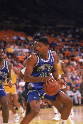 LOS ANGELES - 1990:  Sam Mitchell #42 of the Minnesota Timberwolves dribble drives the ball during a game against the Los Angeles Lakers at the Great Western Forum in Los Angeles, California during the 1989-1990 NBA season.  (Photo by Ken Levine/Getty Ima