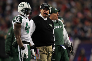 FOXBORO, MA - JANUARY 16:  Head coach Rex Ryan and James Ihedigbo #44 of the New York Jets look on from the sideline during their 2011 AFC divisional playoff game against the New England Patriots at Gillette Stadium on January 16, 2011 in Foxboro, Massach