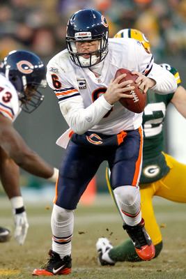 GREEN BAY, WI - JANUARY 02:  Quarterback Jay Cutler #6 of the Chicago Bears is chased out of the pocket by the Green Bay Packers at Lambeau Field on January 2, 2011 in Green Bay, Wisconsin.  (Photo by Matthew Stockman/Getty Images)