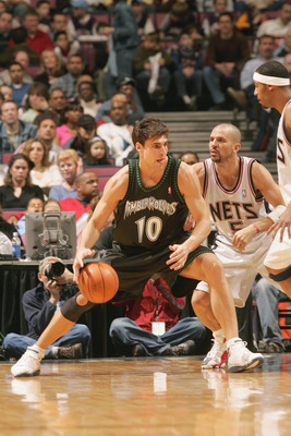 EAST RUTHERFORD, NJ - MARCH 26:  Wally Szczerbiak #10 of the Minnesota Timberwolves dribbles against Jason Kidd #5 of the New Jersey Nets during the game on March 26, 2005 at Continental Airlines Arena in East Rutherford, New Jersey.  The Timberwolves won