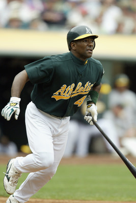 OAKLAND, CA - AUGUST 28:  Miguel Tejada #4 of the Oakland Athletics watches the ball as he runs to first against the Baltimore Orioles during a game at the Network Associates Coliseum on August 28, 2003 in Oakland, California.  The A's won 6-4.  (Photo by
