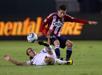 CARSON, CA - OCTOBER 23:  Jorge Flores #19 of Chivas USA and Bratislav Ristic #77 of the Chicago Fire vie for the ball in the first half during the MLS match on October 23, 2010 in Carson, California. The Fire defeated Chivas USA 4-1.  (Photo by Victor De