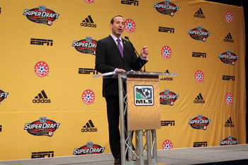 BALTIMORE, MD - JANUARY 13: MLS Commissioner Don Garber speaks from the podium during the 2011 MLS SuperDraft on January 13, 2011 at the Baltimore Convention Center in Baltimore, Maryland. (Photo by Ned Dishman/Getty Images)