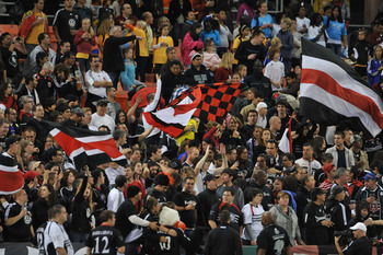 WASHINGTON, DC - OCTOBER 23:  Fans of D.C. United cheer against Toronto FC at RFK Stadium on October 23, 2010 in Washington, DC. Toronto defeated DC 3-2. (Photo by Larry French/Getty Images)