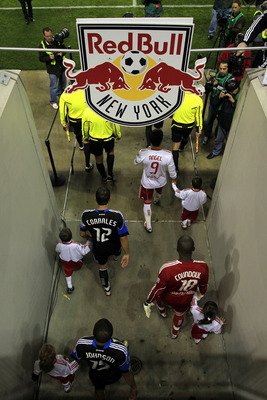 HARRISON, NJ - NOVEMBER 04:  San Jose Earthquakes and the New York Red Bulls enter the field prior to the second leg of the of the MLS playoffs at Red Bull Arena on November 4, 2010 in Harrison, New Jersey. The Earthquakes defeated the Red Bulls 3-2 on ag