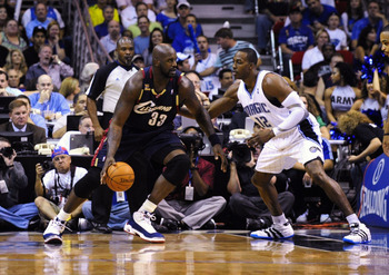 ORLANDO, FL - NOVEMBER 11:  Shaquille O'Neal #33 of the Cleveland Cavaliers looks to maneuver against Dwight Howard #12 of the Orlando Magic during the game on November 11, 2009 at Amway Arena in Orlando, Florida. NOTE TO USER: User expressly acknowledges