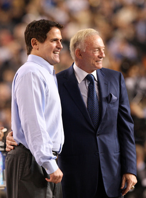 ARLINGTON, TX - FEBRUARY 14:  Owner and general manager of the Dallas Cowboys Jerry Jones (R) and owner of the Dallas Mavericks Mark Cuban look on during the NBA All-Star Game, part of 2010 NBA All-Star Weekend at Cowboys Stadium on February 14, 2010 in A