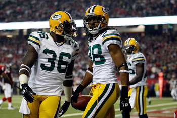 ATLANTA, GA - JANUARY 15:  Tramon Williams (R) #38 and Nick Collins #36 of the Green Bay Packers react after Williams intercepted a pass in the endzone against the Atlanta Falcons during their 2011 NFC divisional playoff game at Georgia Dome on January 15