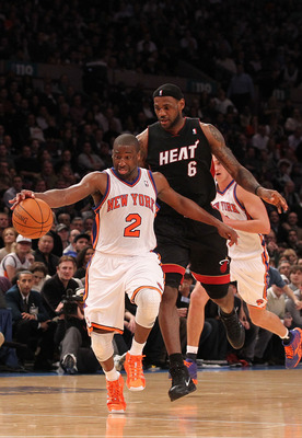 NEW YORK, NY - DECEMBER 17:  Raymond Felton #2 of the New York Knicks dribbles the ball as LeBron James #6 of the Miami Heat gives chase at Madison Square Garden on December 17, 2010 in New York City. NOTE TO USER: User expressly acknowledges and agrees t