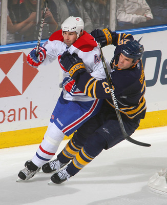 BUFFALO, NY - JANUARY 18: Paul Gaustad #28 of the Buffalo Sabres skates against Roman Hamrlik #44 of the Montreal Canadiens at HSBC Arena on January 18, 2011 in Buffalo, New York.  (Photo by Rick Stewart/Getty Images)