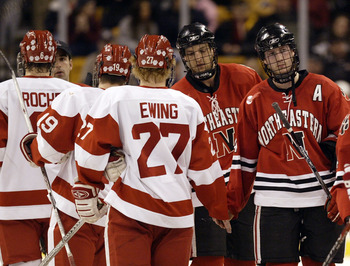 BOSTON - FEBRUARY 05:  Steve Birnstill #44 of the Northeastern Huskies shakes hands with Bryan Ewing #27 of the Boston University Terriers after the first round of the Beanpot Tournament on February 5, 2007 at TD Banknorth Garden in Boston, Massachusetts.