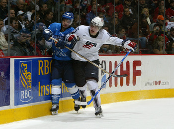 VANCOUVER, CANADA - JANUARY 5:  Blake Wheeler #16 of Team USA checks a Team Finland player during their World Jr. Hockey Championship bronze medal game at General Motors Place on January 5, 2006 in Vancouver, British Columbia, Canada. Team Finland defeate