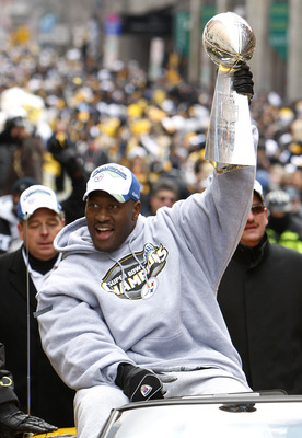 PITTSBURGH - FEBRUARY 03:  James Harrison #92 of the Pittsburgh Steelers shows off the Super Bowl XLIII trophy during a parade on February 3, 2009 in Pittsburgh, Pennsylvania.  (Photo by Gregory Shamus/Getty Images)