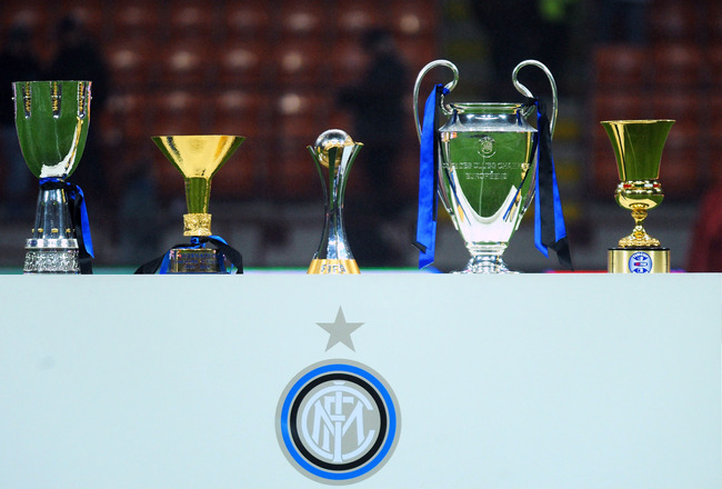 MILAN, ITALY - JANUARY 06:  The five trophies (L-R) the Supercoppa Italiana, the Scudetto trophy, the FIFA Club World Cup trophy, the Champions League trophy and the Coppa Italia won by Inter are displayed before the Serie A match between FC Internazional
