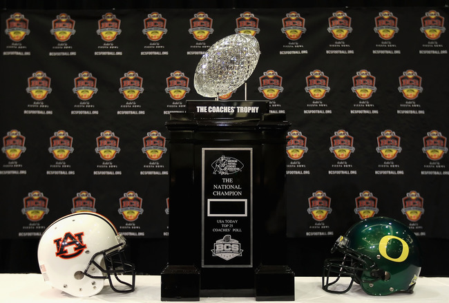 SCOTTSDALE, AZ - JANUARY 07:  The coaches trophy is displayed with helmets for the Auburn Tigers and the Oregon Ducks during Media Day for the Tostitos BCS National Championship Game at the JW Marriott Camelback Inn on January 7, 2011 in Scottsdale, Arizo