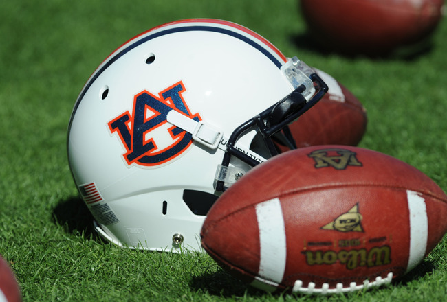 AUBURN, AL - NOVEMBER 06:  A helmet and footballs of the Auburn Tigers are on the field before play against the Chattanooga Mocs November 6, 2010 at Jordan-Hare Stadium in Auburn, Alabama.  (Photo by Al Messerschmidt/Getty Images)