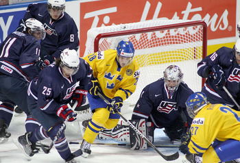 BUFFALO, NY - JANUARY 05: Jesper Thornberg #28 of Sweden skates between Jack Campbell #1 and Justin Faulk #25 of the United States during the 2011 IIHF World U20 Championship Bronze medal game between United States and Sweden at the HSBC Arena on January