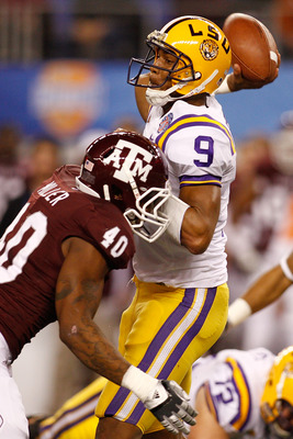 ARLINGTON, TX - JANUARY 07:  Jordan Jefferson #9 of the Louisiana State University Tigers throws under pressure from Von Miller #40 of the Texas A&M Aggies during the AT&T Cotton Bowl at Cowboys Stadium on January 7, 2011 in Arlington, Texas.  (Photo by C