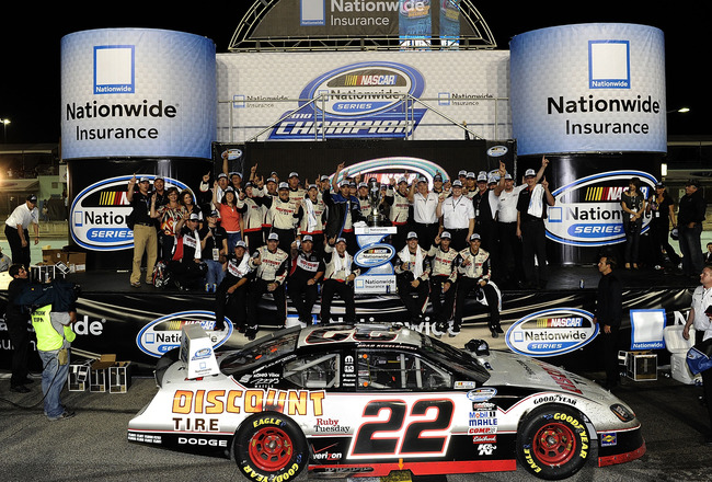 HOMESTEAD, FL - NOVEMBER 20:  Brad Keselowski, driver of the #22 Discount Tire Dodge, celebrates winning the NASCAR Nationwide Series championship with his team following the Ford 300 at Homestead-Miami Speedway on November 20, 2010 in Homestead, Florida.