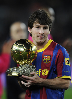 BARCELONA, SPAIN - JANUARY 12:  Lionel Messi of FC Barcelona holds the Ballon d'Or trophy prior the Copa del Rey quarter final first leg match FC Barcelona and Betis at Camp Nou on January 12, 2011 in Barcelona, Spain.  (Photo by David Ramos/Getty Images)