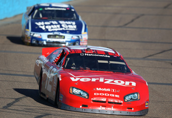 AVONDALE, AZ - NOVEMBER 13: Justin Allgaier, driver of the #12 Verizon Wireless Dodge, leads Carl Edwards, driver of the #60 Copart Ford, during the NASCAR Nationwide Series WYPALL 200 at Phoenix International Raceway on November 13, 2010 in Avondale, Ari