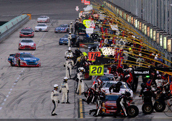 HOMESTEAD, FL - NOVEMBER 20:  Cars make pit stops during the NASCAR Nationwide Series Ford 300 at Homestead-Miami Speedway on November 20, 2010 in Homestead, Florida.  (Photo by Sam Greenwood/Getty Images)