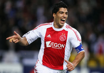 AMSTERDAM, NETHERLANDS - OCTOBER 19: Luis Suarez of AFC Ajax celebrates scoring during the UEFA Champions League Group G match between AFC Ajax and AJ Auxerre at the Amsterdam ArenA on October 19, 2010 in Amsterdam, Netherlands.  (Photo by Bryn Lennon/Get