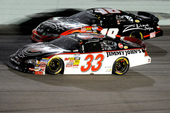 HOMESTEAD, FL - NOVEMBER 20:  Kevin Harvick, driver of the #33 Jimmy John's Chevrolet, leads Kyle Busch, driver of the #18 Z-Line Designs Toyota, during the NASCAR Nationwide Series Ford 300 at Homestead-Miami Speedway on November 20, 2010 in Homestead, F