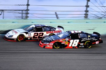 HOMESTEAD, FL - NOVEMBER 20:  Brad Keselowski, driver of the #22 Discount Tire Dodge, races Kyle Busch, driver of the #18 Z-Line Designs Toyota, during the NASCAR Nationwide Series Ford 300 at Homestead-Miami Speedway on November 20, 2010 in Homestead, Fl