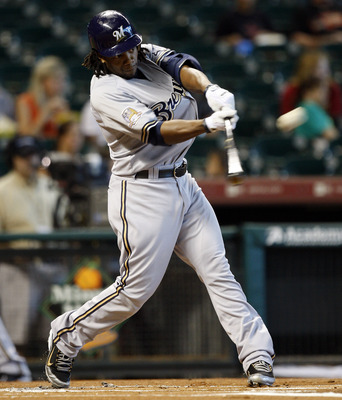 HOUSTON - SEPTEMBER 15:  Rickie Weeks #23 of the Milwaukee Brewers hits a solo home run in the first inning against the Houston Astros in the first inning at Minute Maid Park on September 15, 2010 in Houston, Texas.  (Photo by Bob Levey/Getty Images)