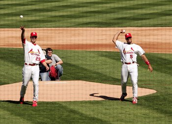 ST. LOUIS - APRIL 10:  Chris Carpenter #29 and Albert Pujols #5 of the St. Louis Cardinals throw out the ceremonial first pitch before the game against the Milwaukee Brewers in the season opener and first Major League Baseball game in the new stadium on A