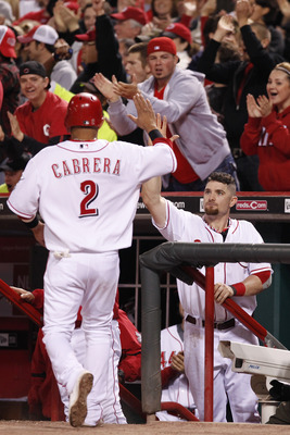 CINCINNATI, OH - SEPTEMBER 28: Jonny Gomes #31 of the Cincinnati Reds greets Orlando Cabrera #2 after he scored the tying run against the Houston Astros at Great American Ball Park on September 28, 2010 in Cincinnati, Ohio. The Reds won 3-2 to clinch the